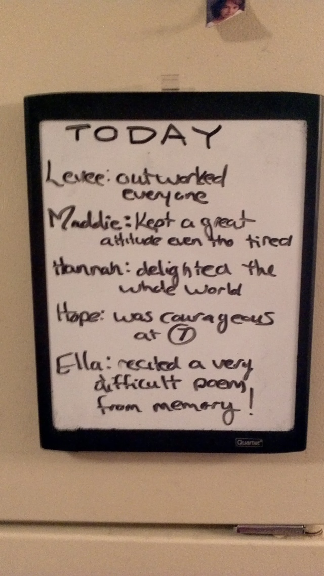enouragement whiteboard on fridge